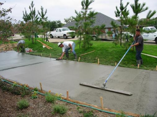 Concrete walkway by roofing contractors