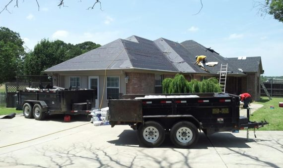 Our roofing contractors repairing a shingle roof in Wylie, TX